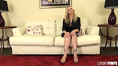 Julia Ann sits on the sunny yellow couch and talks about her sexcapades