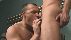 Hunky young stud drops to his knees and worships his partner's big dick